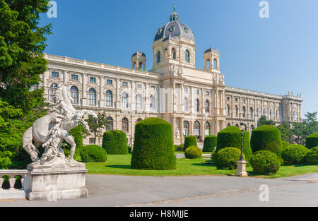 Classic view of famous Naturhistorisches Museum (Natural History Museum) with park and sculpture in Vienna, Austria - Stock Photo