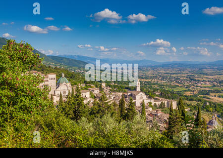 Classic view of the historic town of Assisi ion a sunny day with blue sky and clouds in summer, Umbria, Italy - Stock Photo