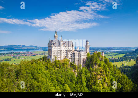 Classic view of world-famous Neuschwanstein Castle, one of Europe's most visited castles, on a beautiful sunny day - Stock Photo