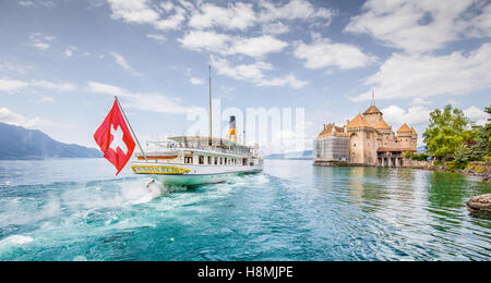 Traditional paddle steamer excursion ship with famous Chateau de Chillon at Lake Geneva in summer, Canton of Vaud, - Stock Photo