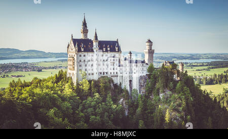 Beautiful view of world-famous Neuschwanstein Castle, the 19th century Romanesque Revival palace built for King - Stock Photo