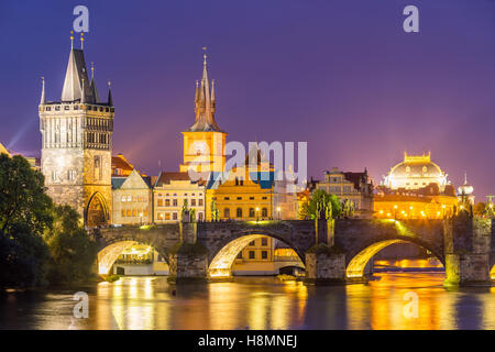 View of the River Vltava and Charles Bridge at Dusk Prague Czech Republic Europe - Stock Photo