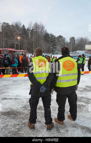 Rescue workers of Missing people organization looking at crowd, Sweden - Stock Photo
