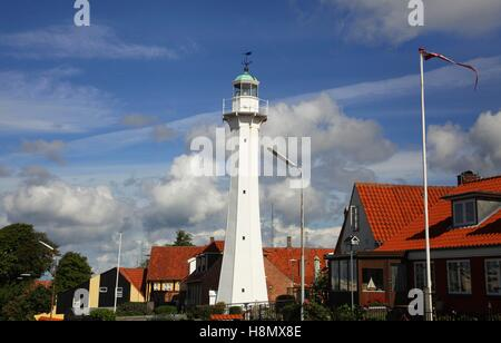 The old white lighthouse, which was built in 1880, is seen in the city of Roenne on the island of Bornholm in the - Stock Photo