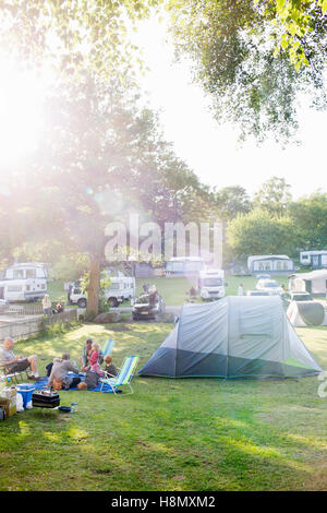 Family with kids (2-3, 4-5, 6-7) camping in campsite - Stock Photo