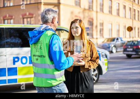 Volunteers on street - Stock Photo