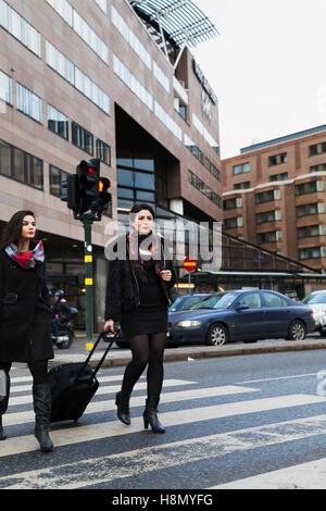 Women crossing street - Stock Photo