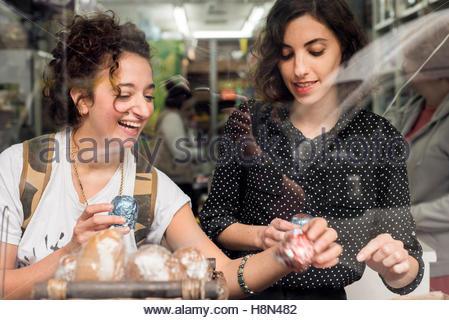 Two women choosing food - Stock Photo