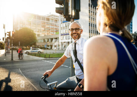 Man and woman in city, man smiling - Stock Photo