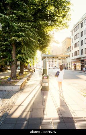 Sweden, Skane, Malmo, Carolikvarteren, Bus stop in city street - Stock Photo