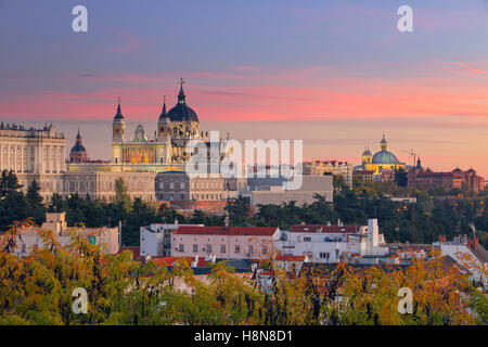 Image of Madrid Skyline with Santa Maria la Real de La Almudena Cathedral and the Royal Palace during sunset. - Stock Photo