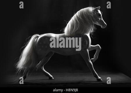Horse Toy on Black Background - Stock Photo