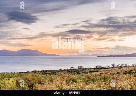 Beautiful and vibrant Scottish sunset landscape view of Isle of Arran from Ardlamont, Tighnabruaich, Argyll & Bute, - Stock Photo
