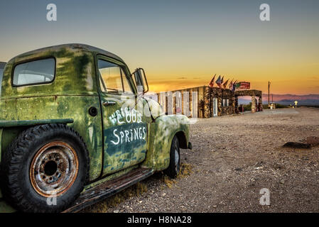 Car wreck and rebuilt Cool Springs station in the Mojave desert on historic route 66 - Stock Photo