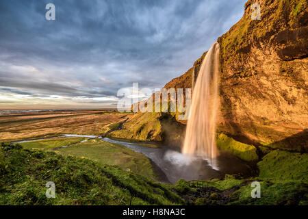 Seljalandsfoss Waterfall in Iceland at sunset. Hdr processed. - Stock Photo