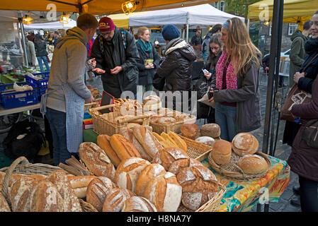 Artisan bread on sale at a stall in the Grassmarket, Edinburgh, Scotland, UK. - Stock Photo