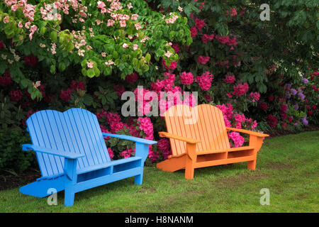 Oregon; Iris And Other Flowering Plants With Chair At Schriners Iris Garden.  Oregon   Stock Photo
