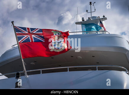 Cayman islands Red Ensign flag on a luxury superyacht - Stock Photo