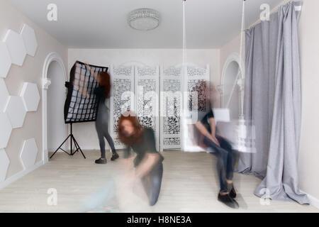 the girl prepares the Studio for a photo shoot - Stock Photo