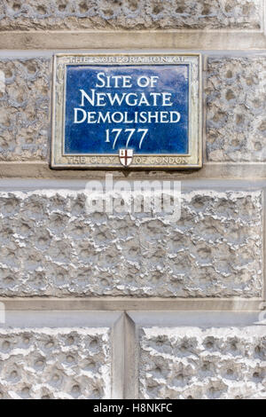 Blue wall plaque commemorating the site of Newgate prison, demolished in 1777, London. - Stock Photo