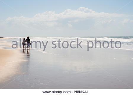 Couple walking on beach - Stock Photo