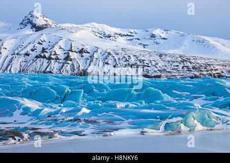 Blue ice formations on Svinafellsjökull, arm of the Vatnajökull, Iceland's largest glacier in winter - Stock Photo