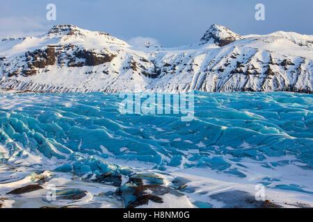 Blue ice on Svinafellsjökull, arm of the Vatnajökull, Iceland's largest glacier in winter - Stock Photo