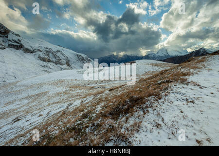 Snowy autumn afternoon at Giau Pass, Dolomites, Italy. - Stock Photo