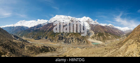 Panoramic view of Manang valley and Annapurna mountains range. Annapurna circuit trek, Nepal - Stock Photo