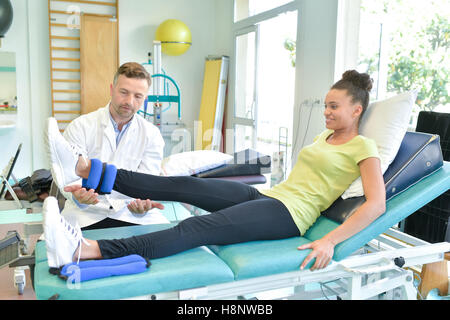 pretty female at the physiotherapist - Stock Photo