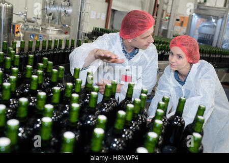 brewery team wearing a uniform inside the workshop - Stock Photo