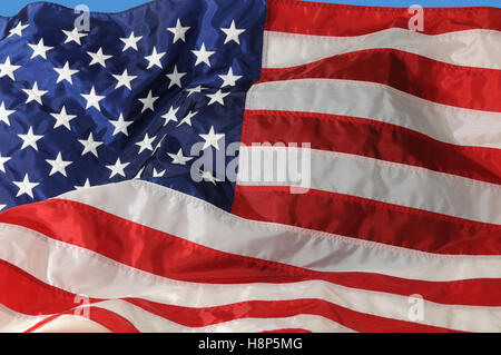 Close-up of of U.S. Flag fluttering in the breeze.. - Stock Photo