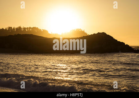 Sun setting over the Point Lobos State Reserve. Monterey County, California, United States. - Stock Photo