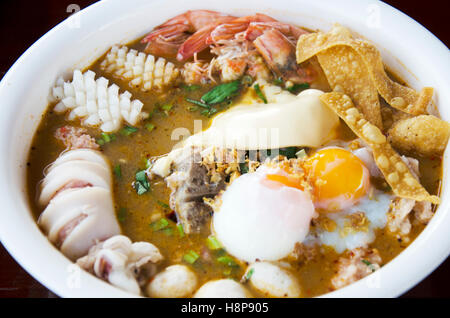 Special noodle spicy soup or noodles tom yam soup thai style with pork and seafood and soft-boiled egg and other - Stock Photo