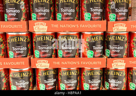 tins of Heinz tomato soup on supermarket shelves - Stock Photo
