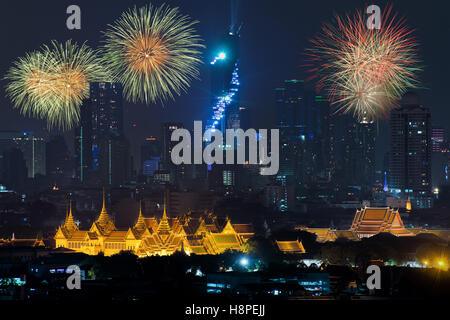 Beautiful fireworks celebrating new year with grand palace and Bangkok city in background at Bangkok, Thailand - Stock Photo