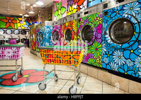 Unique retro painted washer / dryers in a local laundromat, New York City, NY, USA - Stock Photo