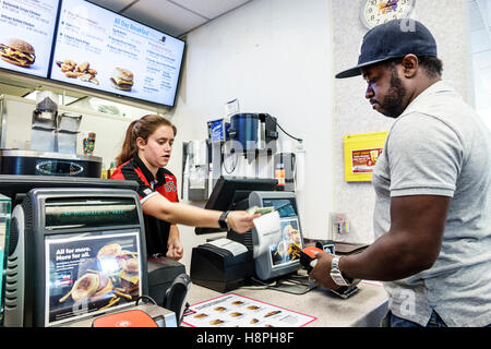 Vero Beach Florida McDonald's restaurant fast food interior counter cashier woman employee Black man paying receiving - Stock Photo