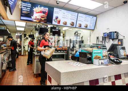 Vero Beach Florida McDonald's restaurant fast food interior counter cashier woman employee - Stock Photo