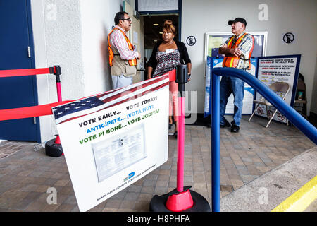 Miami Florida Beach polling place station presidential elections early voting multi multiple languages English Spanish - Stock Photo