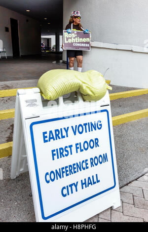 Miami Florida Beach polling place station presidential elections early voting sign campaigner - Stock Photo