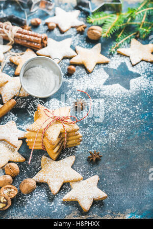 Christmas star shaped cookies with spices and fir-tree branch - Stock Photo