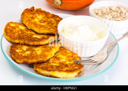 Pumpkin-oatmeal pancakes with curry on a white background - Stock Photo