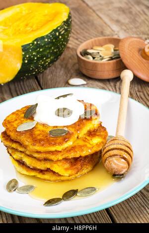 Pumpkin Pancake with honey and seeds - Stock Photo
