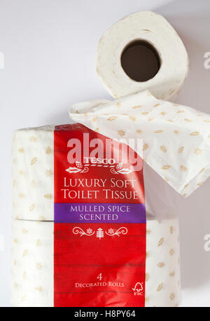 Pack of Tesco luxury soft toilet tissue mulled spice scented 4 decorated rolls with one removed and unravelled unrolled - Stock Photo