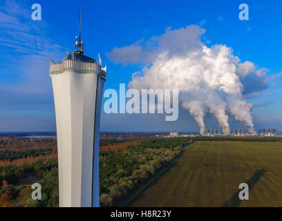 Billows of steam rise from the cooling towers of the brown coal power plant Jaenschwalde of the LEAG (Lausitz Energy - Stock Photo