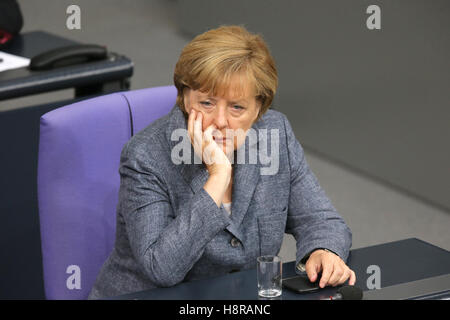 FILE - A file picture dated 19 August 2015 shows German Chancellor Angela Merkel sitting in the German Bundestag - Stock Photo