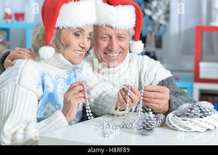 Senior couple in Santa hats - Stock Photo