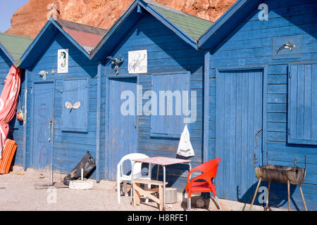 Fisherman's huts on beach near Albufiera in Portugal - Stock Photo