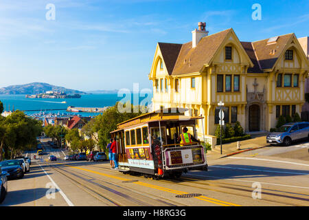 Combined scenic view of San Francisco Bay with Alcatraz, cable car, Victorian houses, typical iconic siteseeing - Stock Photo